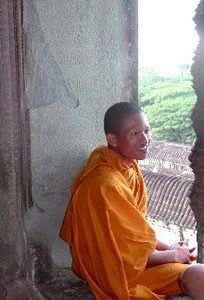 Angkor-Wat-Laos-Ancient-Khmer-Empire-Tour-monk-window
