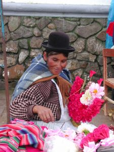 Bolivian woman with flowers Far Horizons archaeology tour