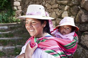 Bolivian woman carrying her baby, Isla del Sol, Bolivia